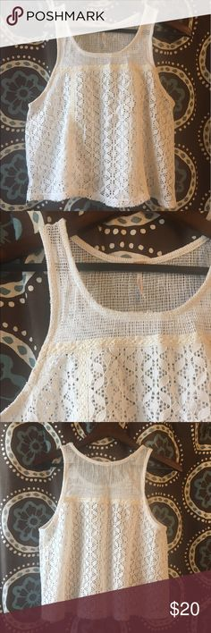 Free People lace tank Very cute creme/off-white free people lace top. No liner, intended to be worn over a shirt or dress. Lightly worn, size large, in great condition! Free People Tops Tank Tops