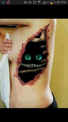 Cheshire cat eyes tattoo
