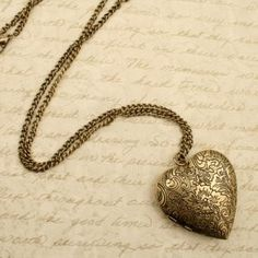 i love a special locket to keep pictures of loved ones in. it goes with everything