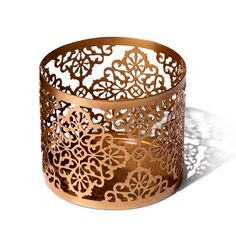 """Beautiful cutout metal sleeve to fit Avon's 11 oz. candle jars (sold separately). 4 1/4"""" diam. x 3 1/3"""" H. Imported."""