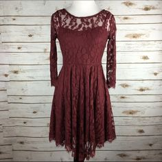 """[Free People] Floral Mesh Lace Dress Boho Chic 4 Floral embroidered mesh mini dress with lightly pleated skirt. Slip dress is attached underneath and has adjustable shoulder straps. Sleeves and neckline are left sheer. Bottom hem is trimmed with a scalloped lace. 3/4 sleeve. Hidden side zip.  Color: Burgundy Fabric: 70% Cotton 30% Nylon Size: 4 Bust: 15"""" Length: 34"""" Condition: NWOT. Never been worn. No flaws.  No Trades! No PayPal! Free People Dresses Mini"""