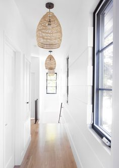 Hallway Lighting ideas modern farmhouse - Spacious entry hallway allows you to add bigger lighting sources. Upstairs Hallway, Entry Hallway, White Hallway, White Walls, Bright Hallway, Hallway Lamp, Wall Lamps, Rattan Lampe, Hanging Lamp Design