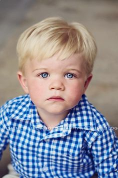 This little boy is so cute! I love the shirt, and his hair and eyes are amazing!