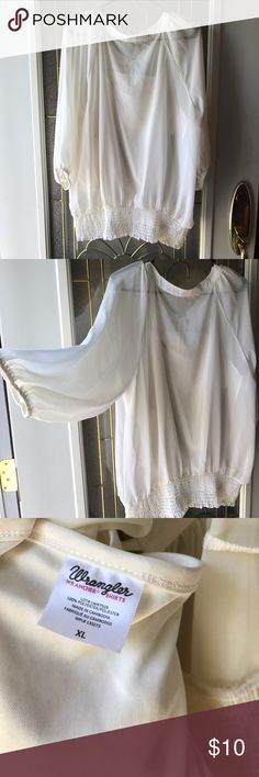 Off White Blouse This off white blouse is light and flowing. It has an attached camisole underneath the shear outside. It is a half sleeved shirt with no rips or stains. Comes from an animal and smoke free home! Wrangler Tops Blouses