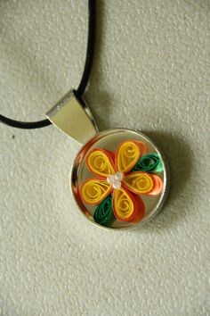 Paper Quilling.  These would make great resin pendants.  Now, I just neat to learn to quill.  ;)
