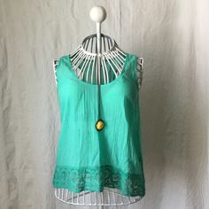 NWOT Aerie Spring Green Tank Top Please feel free to make an offer! I'd be happy to answer any questions or help you bundle up a few of your favorites at a discounted price! :) aerie Tops Tank Tops