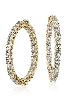 Beautifully crafted, these hoop earrings feature round diamonds set in 18k yellow gold.