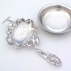 #Tea Strainer, for #BlackTea, #Teaware, This is a beautiful platinum-plated handmade tea strainer.   This is very unique and elegant.   We use a technology of making the jewelry to make a delicate and high grade product.   And our product looks so good on any #table setting, with pottery.  We wish you have a beautiful teatime with our products.  .Design Motif: Deep Sea Organism  www.etsy.com/shop/TITASY  http://titasy.dawanda.com