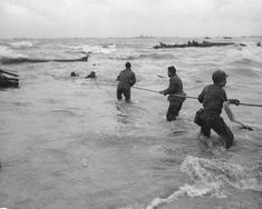 American troops used a lifeline to rescue several men from a sunk landing craft, Normandy, 6 Jun 1944  Source   United States National Archives Identification Code   SC 320869