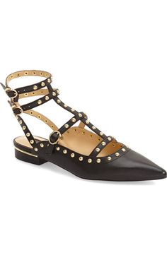 Rounded studs, slim buckle straps and a pointed toe add  an edgy modern appeal to trendy sandal.