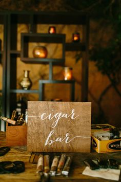 Every guy could enjoy a killer cigar bar! And that sign.