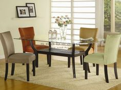 This stunning contemporary Coaster 101491 Bloomfield Glass Dining Table Set will be a lovely addition to your casual dining room. The sleek rectangular beveled glass top rests above a beautiful wooden base. The base has smooth angular legs, finished in a rich dark Cappuccino for a bold look. An Asian inspired slatted shelf below creates a great storage and display area, while giving this table the perfect distinctive style for your home.