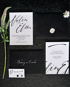 I really like this bold modern invitation suite. Replace black with dark blues/greys