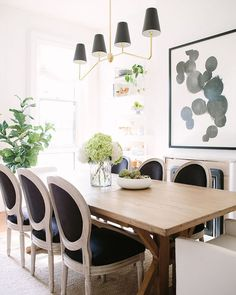 The mix of farmhouse lodge modern and French Country in this dining room by @alainakaz is stunning! We found a similar style table in this #dailyfind for way less. https://cpycat.ch/2hyY3gg #copycatchic #CopyCatChic