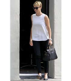Charlize Theron    Viktor & Rolf's Bombette bag  in Black Leather adds a sculptural element to Theron's minimalist ensemble.