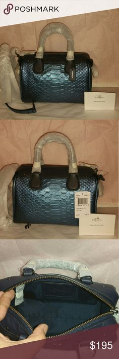Coach mini Bennett crossbody Embossed Snake Leathe This is beautiful and mini coach crossbody bag Snake embossed Leather  Inside zip cellphone and multifunction pockets Zip-top closure faric lining Handles with 3 drop  Longer strap  with 23 for shoulder or crossbody wear Coach Bags Mini Bags