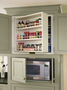 organized pantry and kitchen space. kitchen cabinets with swing out shelves and microwave storage, whole house remodel farmhouse addition Farmhouse Kitchen Cabinets, Kitchen Cabinetry, Kitchen Redo, Kitchen Pantry, New Kitchen, Kitchen Storage, Kitchen Ideas, Kitchen Organization, Cheap Kitchen