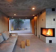 What do you think of this interior? House in Brissago designed by Wespi de Meuron Romeo Architects Tag your friends! ________ Location: - Architecture and Home Decor - Bedroom - Bathroom - Kitchen And Living Room Interior Design Decorating Ideas - Concrete Fireplace, Concrete Houses, Fireplace Design, Concrete Walls, Precast Concrete, Concrete Light, Fireplace Seating, Fake Fireplace, Fireplace Outdoor