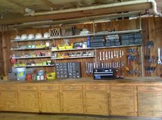 organized garage with shelves and long work bench