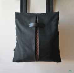 👉👉👉👉👉 Free shipping to Greece!   « THE SECRET black waterpoof   brown cotton» is a lightweight backpack / messenger bag, geometrically cut, minimally designed. As a practical, every-day bag, it can be worn either on one shoulder by letting the one strap free or as a messenger bag. Suitable and safe for documents, books, iphone, water bottle, cosmetics and more! Comfortable, functional and stylish at the same time! Available in three sizes!  >> Specifications Features: *Adjustable…