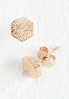 Since You Been Hexagon Earrings in Rose Gold. Once you catch a glimpse of these rose-gold earrings, you wont be able to go back to simple spheres and four-sided polygons. #gold #modcloth