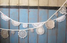Google Image Result for http://wedding-pictures-04.onewed.com/33093/vintage-inspired-wedding-decor-lace-doily-bunting__full-carousel.jpeg