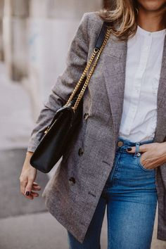 Denim styled with a buttoned plaid blazer
