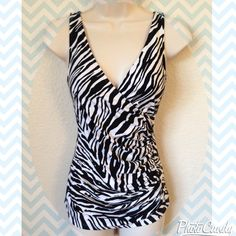 Gorgeous Express wrap style top! Beautiful top with zebra pattern by Express! Wrap style with deep neckline-- very flattering!! Work but still in great condition.. Size XS Express Tops Tank Tops
