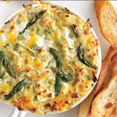 Spring Vegetable and Goat Cheese Dip recipe | Epicurious.com. Make with artichokes and spinach.