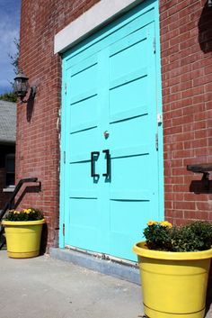 turquoise door with yellow accent