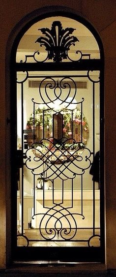 Wrought iron doors are indeed a style from the past. With creativity, you can make your house look more sophisticated with the wrought iron front doors. Portal, Entrance Doors, Doorway, Door Knockers, Door Knobs, Shop Doors, Door Gate, Unique Doors, Iron Gates