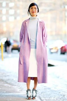 Lavender coat layered over a colorblocked knit and turtleneck.
