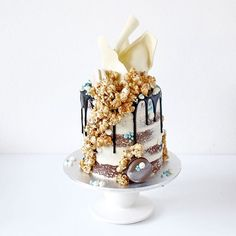 "Cakes By Cliff on Instagram: ""It has been a while since I made my popcorn cake for @merveille_french_eventstyling's birthday! This is a semi naked white chocolate caramel mud cake with salted caramel popcorn with @unbirthdaybakery inspired pipe details."""