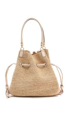 """ANNABEL INGALL """"Roane Drawstring Raffia Bag"""" $365 -- A classic beach-ready bag gets a sophisticated revamp. This raffia tote is cinched with tasseled leather cords, and double rolled handles anchor the slouchy silhouette. The unlined interior has a leather zip pocket.    Weight: 32oz / 0.9kg.  Imported, China.    MEASUREMENTS  Height: 13in / 33cm  Length: 15in / 38cm  Depth: 6in / 15cm  Handle drop: 10in / 25.5cm"""