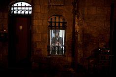 Happy Hanukkah: Jerusalem Dec. 8, 2012 - A Jewish man lights the first Hanukkah candle inside his home in Mea Shearim.