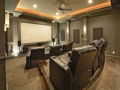 Traditional Home Theater with Ceiling fan, Crown molding, Wall sconce, flush…