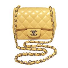 Chanel Yellow Lambskin Mini Classic Flap Shoulder Bag | From a collection of rare vintage handbags and purses at https://www.1stdibs.com/fashion/accessories/handbags-purses/