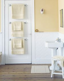 Towel Bar Trio. Few bathrooms have enough places to hang towels. Stacking towel bars behind closed doors is a great way to remedy the shortage and use space efficiently. A flat or single-paneled door provides a crisp frame for three bars; furthermore, it's easier to affix them to a wooden door (as most are) than to a wallboard or a plaster wall. Hang the hardware according to package instructions, evenly spacing the bars along the length of the door.