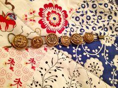 Vintage Metal Button Bracelet. $20.00, via Etsy.