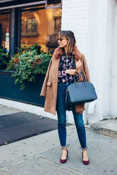 Floral blouse + high waisted jeans + faux fur trim collared camel coat + velvet ankle wrap heels