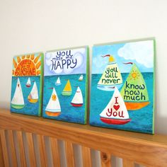 "Set of 3 sailboat themed paintings with the words to ""You Are My Sunshine"" painted into the scene."