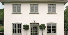 White house with french grey windows… Almost identical to the colors of our house