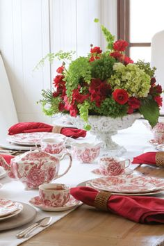 Valentine's Day Tea Table Setting - Red and white are the colors of Valentine's Day, but for this tablescape we've added a pop of spring green in the flower arrangement. It's the perfect counterpoint to red roses and red-and-white toile china—here, Johnson Brothers English Chippendale Red.