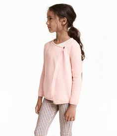 Gray melange. Wrapover cardigan in soft, fine-knit cotton fabric. Button at top.