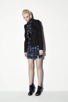 McQueen again creates a more tailored jacket with a longer notched collar and only two closure buttons. I love how tailored it is, when it's worn you'll be able to see the curvature of the women wearing it.