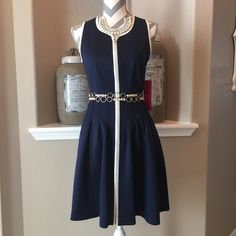 Betsey Johnson Fit & Flare Dress Sz.6 Adorable navy & white Betsey Johnson dress. Dress zips all the way to bottom of dress. Fitted at the top through below the waist with small soft pleats on skirt. Dress is 95% polyester & 5% spandex, dry clean only. I dressed it up with a pearl belt & necklace & of course I dressed it down with boots & more casual necklace. Would be pretty with a scarf tied around the waist. NWT Betsey Johnson Dresses
