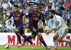 Pour son premier match avec Barcelone, Luis Suarez s'est distingué par quelques gestes de classe, dont une superbe passe vers Neymar sur l'ouverture du score. Mais l'Uruguayen aura finalement connu la défaite pour ses débuts... (AFP/Gérard Julien)
