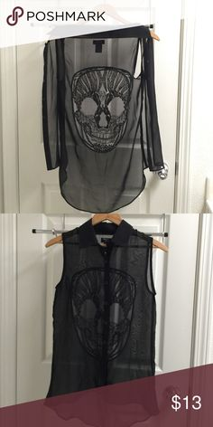 Skull tank top Sheer, button up top with pretty embroider-like skull on back. There's a tiny hole from where the tag is sewn into the garment (see on the picture- bottom left of brand tag), but not that noticeable from a far. Other than that, it's in great shape. Hot Topic Tops Button Down Shirts