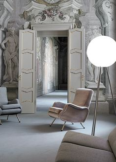 Living Room. Mid-century Italian chairs add contrast to a fresco-walled palazzo. Marco Zanuso chairs.