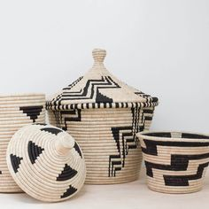 Handwoven in Uganda by a cooperative of twenty women, this oversized, lidded basket is a beautiful and functional storage solution for any space.